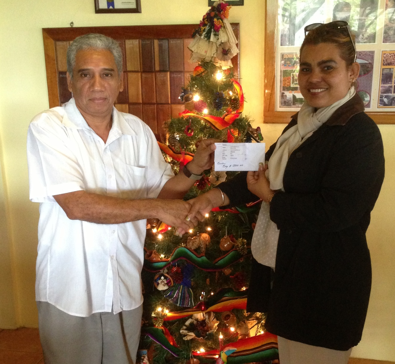 (Left) Octavia Waight Centre representative receiving the cash donation from Ms Cynthia Robateau (Right) of Cahal Pech Village Resort